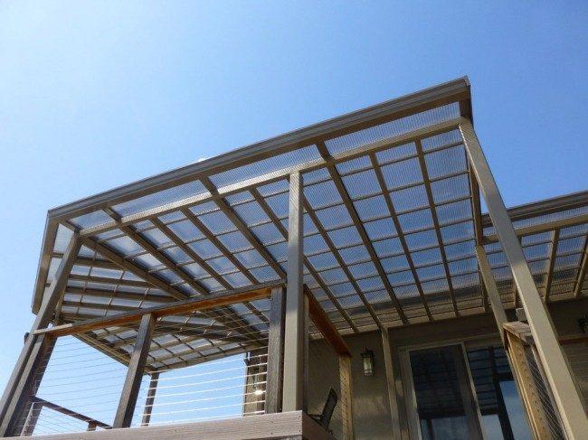 Навесы, пристроенные к дому, из поликарбоната (52 фото): функции, типы, плюсы и минусы
